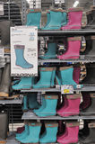 Wellington, rubber or rain boots in a store. Stock Images