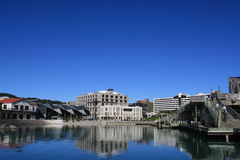 Wellington waterfront, New Zealand. This is Wellington waterfront reflecting the building on a perfectly calm day, which is unusual Royalty Free Stock Image