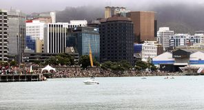 Wellington Waterfront, New Zealand. Wellington, New Zealand - January 21 2013: Crowds of people gather for the annual Birdman Wellington event royalty free stock photos