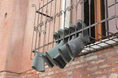 Wellingtons. Hang to be dried in Venice, Italy Stock Photos