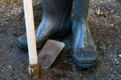 Wellingtons and Hoe Stock Photography