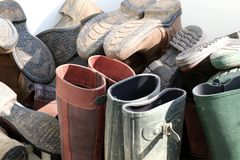Wellingtons and riding boots. Collection of boots including wellies, riding boots and country boots. The boots are stacked in a corner ready for use, some are royalty free stock photography