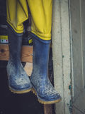 Wellingtons in a shed Stock Image