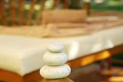 Wellnes and massage oasis in nature with stones Royalty Free Stock Photos