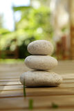 Wellnes and massage oasis in nature with stones Royalty Free Stock Image