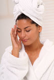 Wellness. Brunette woman wearing a white bathrobe royalty free stock photo