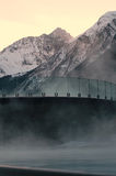 Wellness In The Alps. This picture shows a steaming pool in a wellness resort in the alps during sunset Stock Photos