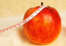 Wellness apple. Red apple and measure tape for wellness programm Stock Photo