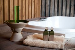 Wellness area. With jacuzzi, towel and bath oil bottles Royalty Free Stock Photography