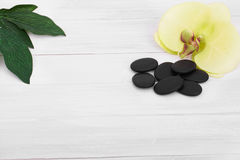 Wellness background with orchid flowers and spa tools: cream, lotion, towel and Royalty Free Stock Photo