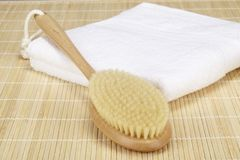 Wellness - bath brush on a folded towel Royalty Free Stock Photo