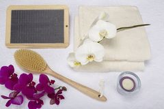 Wellness - Bath brush, towels and decoration with slate Stock Photo
