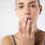 Wellness and beauty. A portrait of a young pretty woman lightly touching her lips with fingertips .Beauty concept Stock Photos