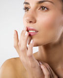 Wellness and beauty. A portrait of a young pretty woman lightly touching her lips with fingertips .Beauty concept Royalty Free Stock Photos