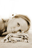 Wellness beauty portrait. Portrait of a fresh and beautiful blond woman on a towel with flowers Stock Images