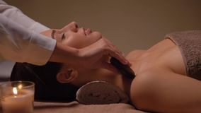 Close up of woman having hot stone massage at spa stock video footage