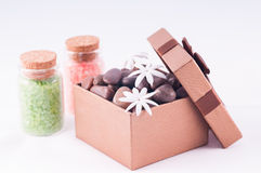 Wellness bronze gift box with bath salts close up Royalty Free Stock Image