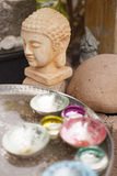 Wellness buddha. Candles and buddha statue as symbol of wellness Royalty Free Stock Photography