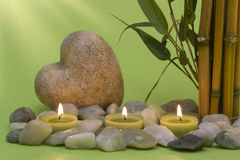Wellness candles and a heart Royalty Free Stock Photography