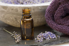 Wellness care products lavender oil and a towel Royalty Free Stock Photography