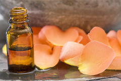 Wellness care products roses oil with petals Royalty Free Stock Images