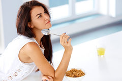 Wellness concept. Woman eating cereal and smiling. Healthy break. Wellness concept. Beautiful young woman eating organic cereal and smiling. Healthy breakfast in stock image