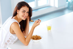 Wellness concept. Woman having breakfast and smiling. Healthy ea Royalty Free Stock Photo