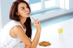 Wellness concept. Woman having breakfast and smiling. Healthy ea Stock Photos