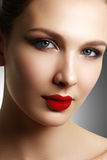 Wellness, cosmetics and chic retro style. Close-up portrait of s. Ensuality beautiful woman model face with fashion make-up and evening red lips makeup. High royalty free stock photos