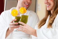 Wellness - Couple with Chlorophyll-Shake in Spa. Young couple - men and women - drinking Chlorophyll-Shake in spa Royalty Free Stock Photography