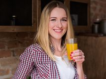Wellness diet drink organic orange juice woman. Wellness diet drink. natural delicious organic orange juice. smiling healthy young woman holding a glass of fresh royalty free stock photo