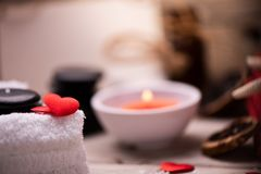 Wellness docoration on valentine`s day with candels and stones royalty free stock photo