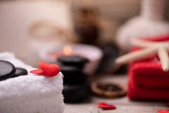 Wellness docoration on valentine`s day with candels and stones stock image