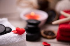 Wellness docoration on valentine`s day with candels and stones royalty free stock images