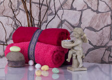 Wellness Easter still life with red touwels, eggs and angel cand Royalty Free Stock Image