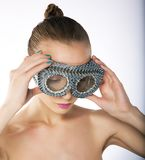 Wellness - female in metallic silver binoculars Stock Image