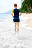 Wellness. Fit Athletic Man Running On Beach,Jogging During Worko. Wellness. Fit Athletic Man Running On Beach, Training For Marathon. Sporty Male Runner Jogging Stock Photos