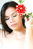 Wellness girl with red flower Royalty Free Stock Photography