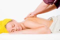 Wellness girl series shoulder massage Royalty Free Stock Images