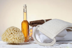 Wellness kit, Sponge towels and bath oil Royalty Free Stock Photos
