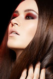 Wellness, make-up. Beautiful long shiny hair model Stock Photos