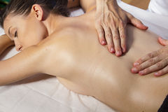 Wellness. Masseur doing massage on woman body in the spa salon. Royalty Free Stock Photo