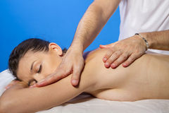 Wellness. Masseur doing massage on woman body in the spa salon. Stock Photography