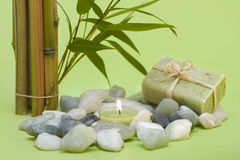 Wellness motive with stones and candle Stock Photos