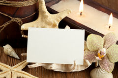 Wellness oasis. Shells and candles on wooden table Stock Photos