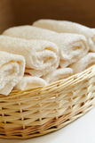 Wellness objects. Basket of pure white towels Stock Photography