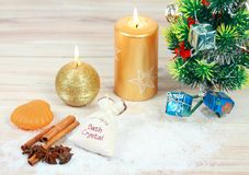 Christmas spa concept with candles and Christmas tree. Stock Image