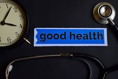 Wellness on the print paper with Healthcare Concept Inspiration. alarm clock, Black stethoscope.Good Health on the print paper wit. Good Health on the print royalty free stock images