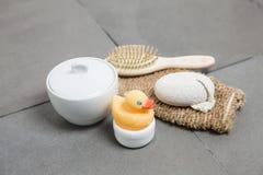 Wellness, rubber duck, hairbrush, glove, pumice stone and bowl Stock Photo