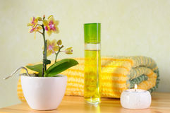 Wellness set with candle. A decorative wellness set with an orchid, perfume, towel and candle Stock Images